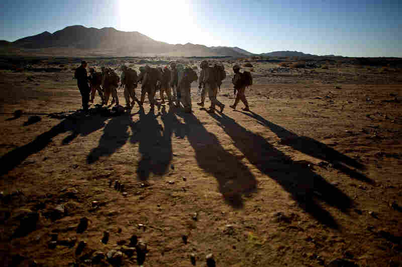 Male and female Marines hike up to a range at Twentynine Palms for a live-fire exercise.