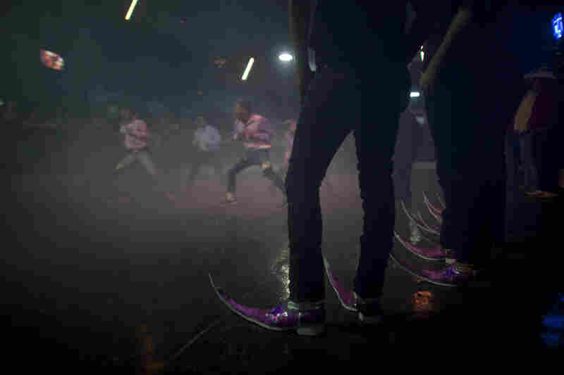 The Parranderos dance crew waits its turn to show off its moves at the Mesquit Rodeo nightclub in Matehuala in 2011.