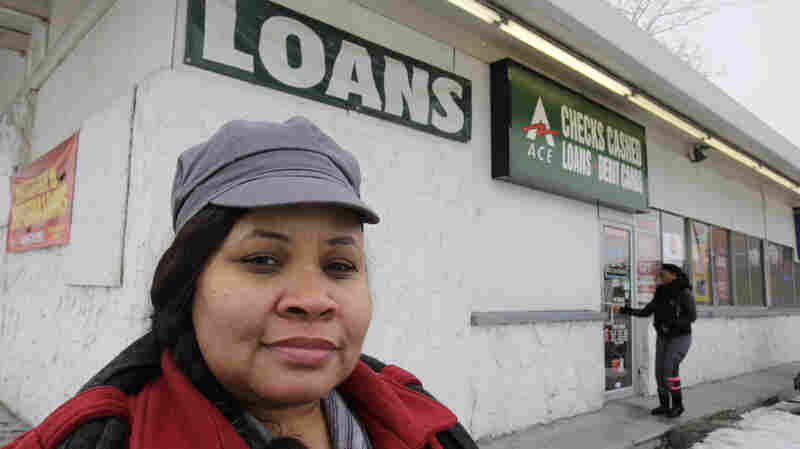 Maranda Brooks stands in January outside a payday loans business that she used to frequent. Troubled by consumer complaints and loopholes in state laws, federal regulators are proposing expansive, first-ever rules on payday lenders, aimed at helping cash-strapped borrowers from falling into a cycle of debt.