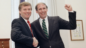 Newly sworn-in Sen. Dan Coats, right, shakes hands with Vice President-elect Dan Quayle in 1989 after Coats took the Senate oath. Coats was chosen to succeed Quayle as senator.