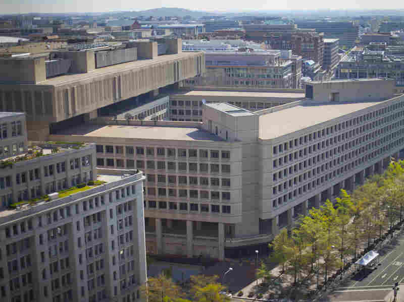 """FBI headquarters in Washington. An independent review says the bureau has made strides since Sept. 11 but """"needs to accelerate its implementation of reforms."""""""
