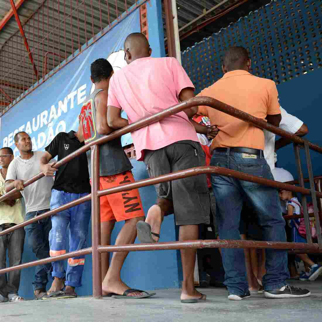 People, most of them unemployed, line up March 19 at a popular Itaborai, Brazil, restaurant where they can have lunch for about 30 cents. The Petrobras refinery and processing plant on the outskirts of town has been shut down; tens of thousands are now out of work in the area.