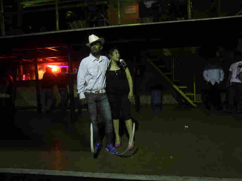 Guadalupe Silva, 20, takes a break from dancing with his girlfriend, Maria Concepcion Hernandez, 22, at a Matehuala nightclub in 2011.