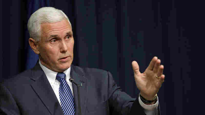 Indiana Gov. Mike Pence holds a news conference at the Statehouse in Indianapolis, on Thursday, where he signed into law a bill that would allow business owners with strong religious convictions to refuse to provide services to same-sex couples.