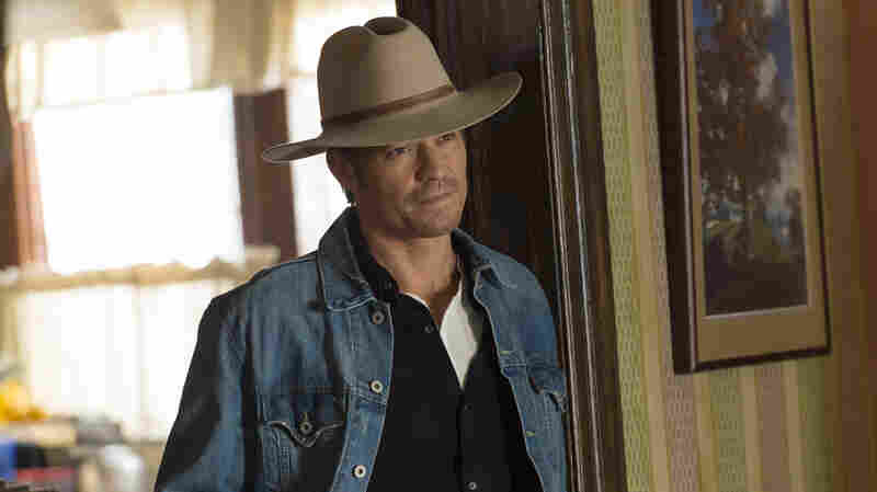 "Timothy Olyphant plays Deputy U.S. Marshal Raylan Givens on FX's Justified, which is based on a novella by Elmore Leonard. The show's creator, Graham Yost, says the only ""tussle"" the writers had with Leonard happened during the pilot, over which hat Raylan should wear."