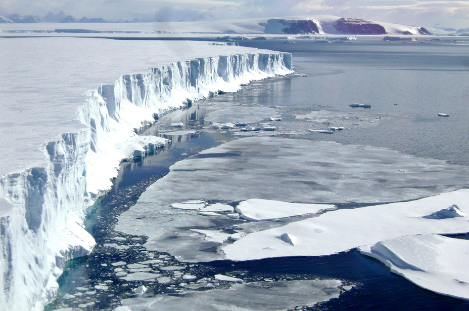 A 2008 view of the leading edge of the Larsen B ice shelf, extending into the northwest part of the Weddell Sea. Huge, floating ice shelves that line the Antarctic coast help hold back sheets of ice that cover land. (Mariano Caravaca /Reuters/Landov)