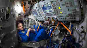 NASA astronaut Scott Kelly is seen inside a Soyuz simulator at the Gagarin Cosmonaut Training Center on March 4 in Star City, Russia. Kelly, along with Russian cosmonaut Mikhail Kornienko of the Russian Federal Space Agency, are scheduled for launch Friday aboard