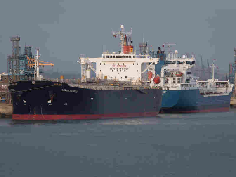 An oil tanker is berthed in Southampton, U.K. The price of crude rose about 5 percent Thursday over fears of disruption in the global oil market after airstrikes by Saudi Arabia against rebels in Yemen.