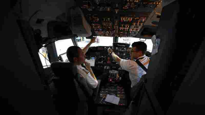 A Southwest Airlines pilot and co-pilot preparing for a flight from Dallas last year. In the wake of the Germanwings crash this week, many European airlines are rushing to adopt a two-person cockpit rule similar to the one already in place in the U.S.