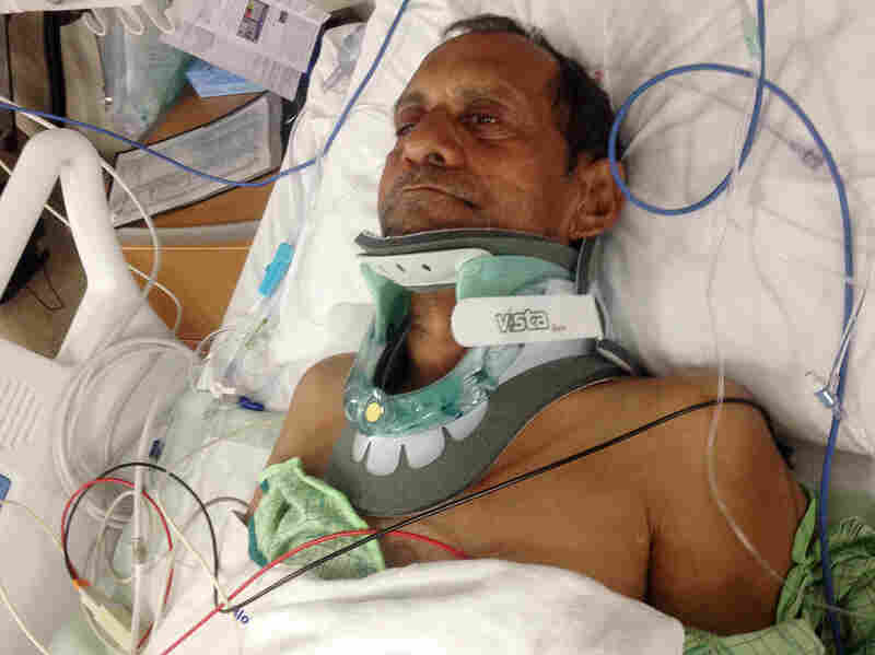 Sureshbhai Patel lies in a bed at Huntsville Hospital in Huntsville, Ala., on Feb. 7. Patel was severely injured when police threw him to the ground.