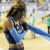 Olympic gold medalist Sanya Richards-Ross pulls on compression sleeves before a 400-meter race at the World Indoor Athletics Championships in Istanbul in 2012.
