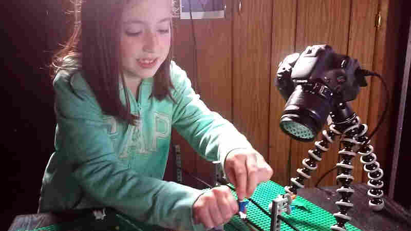 Paul Hollingsworth and his 8-year-old daughter, Hailee, worked together on a Jurassic Park parody video using Lego bricks.