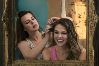 With the help of her friend Maggie (Debi Mazar), single mom Liza (Sutton Foster) recasts herself as a 26-year-old in order to get a coveted publishing job. The new TV Land comedy Younger, made by Sex and the City creator Darren Star, premieres March 31.