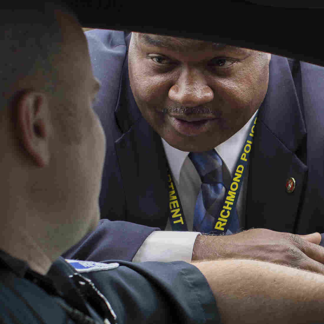 """Detective Mark Williams (right) speaks with an officer in Richmond, Va. A decade ago, amid a surge in violent crime, Richmond police were identifying relatively few murder suspects. So the police department refocused its efforts to bring up its """"clearance rate."""""""