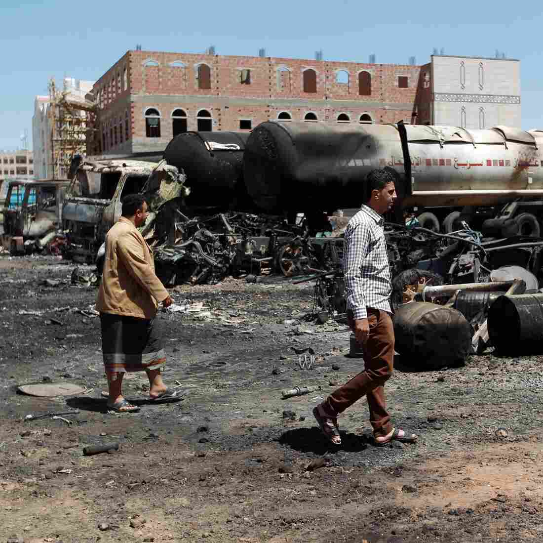 Yemenis walk past near oil tankers that were burnt during clashes between Shiite Houthi rebels and their opponents in the capital, Sanaa, in September. Saudi Arabia launched airstrikes this week to counter the Houthis' offensive.