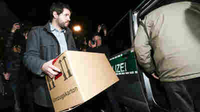 A German police investigator carries a box after searching an apartment believed to belong to the crashed Germanwings flight 4U 9524 co-pilot Andreas Lubitz in Duesseldorf, on Thursday.