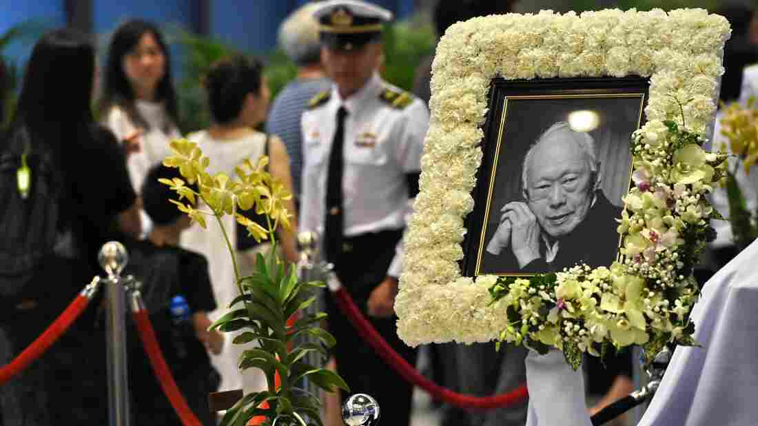 Mourners pay their respects to Singapore's former prime minister Lee Kuan Yew on Friday. Lee, who died last week at age 91, led Singapore's economic transformation.