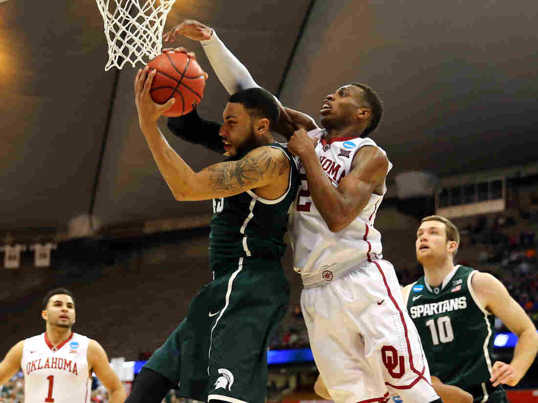 Oklahoma's Buddy Hield (right) and Denzel Valentine of Michigan State played in Friday's East Regional Semifinal of the 2015 NCAA tournament in Syracuse. If you've got money riding on this year's NCAA tournament, you might want to hear about what happened to John Bovary's football pool.