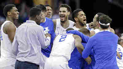 Kentucky players celebrate after a 68-66 win over Notre Dame on Saturday. The 38-0 Wildcats advanced to the Final Four.