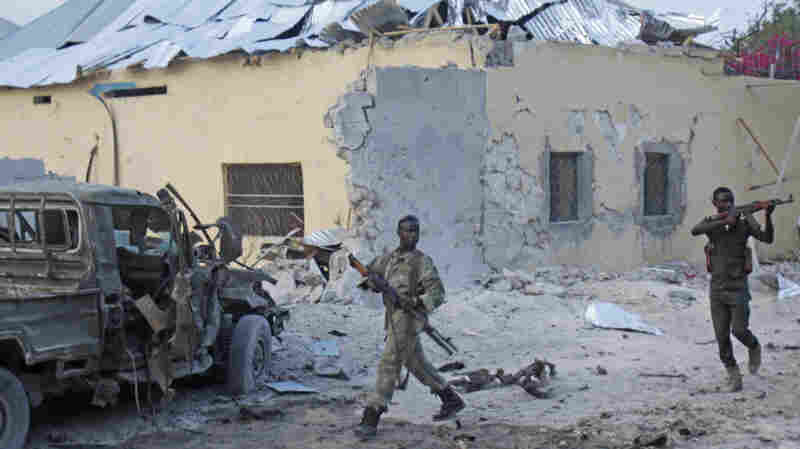 Somali soldiers take position after a bomb was detonated at the gate of one of Mogadishu's most popular hotels Friday. Police said a suicide bomber  detonated his explosives-laden car at the hotel gate.