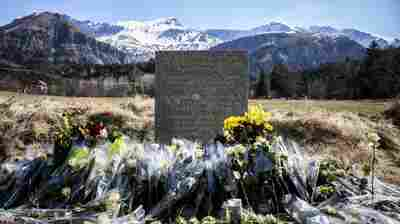 A stone memorial lies near the site in the French Alps where a Germanwings passenger jet crashed on Tuesday. Investigators believe the jet's co-pilot brought it down deliberately.