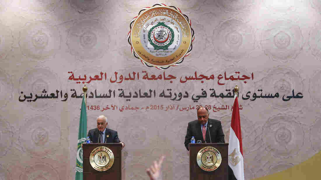 Secretary-general of the League of Arab States Nabil Elaraby (left) and Egyptian Foreign Minister Sameh Shukri attend a news conference after the closing session of the Arab League Summit in Sharm el-Sheikh, Egypt, on Sunday. The 22-nation body agreed in principle to establishing a regional security force.