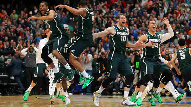 Michigan State is headed back to the Final Four, where they'll meet Duke next Saturday night. Afterward, Wisconsin takes on the still-unbeaten Kentucky Wildcats.