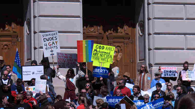 Some of the hundreds of people who gathered outside the Indiana Statehouse on Saturday, for a rally against legislation signed Thursday by Gov. Mike Pence.