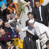 Pope Francis blesses a baby after celebrating a Palm Sunday Mass in St. Peter's Square, at the Vatican, on Sunday.