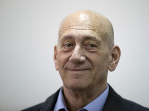 Former Israeli Prime Minister Ehud Olmert waits in a courtroom in Jerusalem's District Court on Monday. The court later found him guilty of accepting bribes in a retrial on corruption charges.