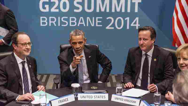 (From left) French President Francois Hollande, President Obama, and British Prime Minister David Cameron at the G-20 summit in Brisbane, Australia, in November 2014.