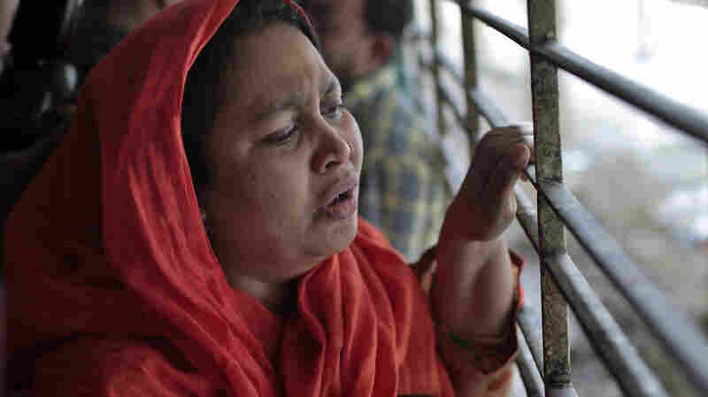 Shilpi, a cousin of Bangladeshi blogger Washiqur Rahman, is seen outside a morgue at the Dhaka Medical College in Dhaka, Bangladesh, on Monday. The blogger was hacked to death Monday morning by three men in the capital, police said.