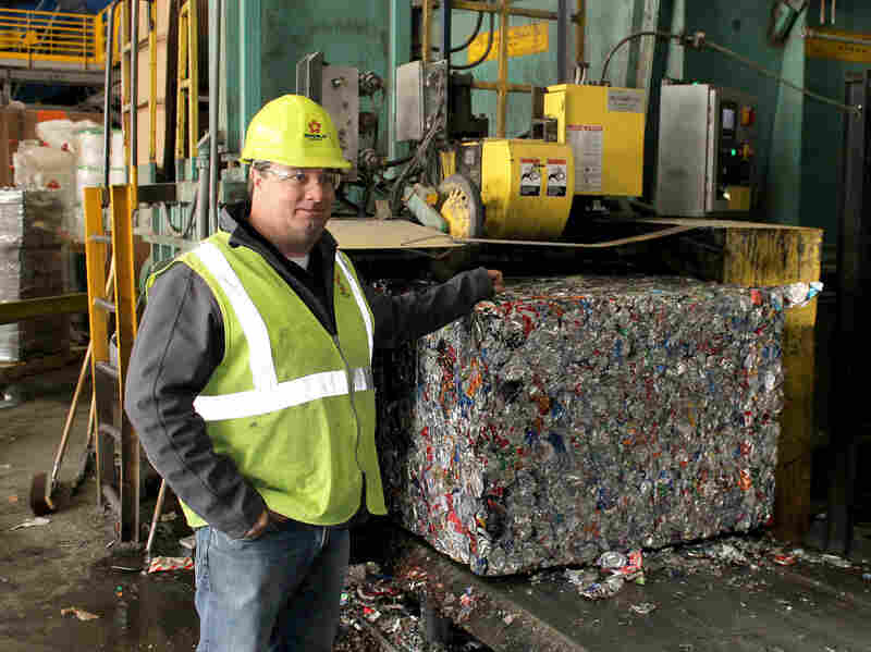 Republic Services' recycling general manager, Brent Batliner, explains how aluminum cans are compressed into 1,500-pound bales at his company's MRF in Hazelwood, Mo. Valued at about $1,200 per ton, aluminum is the most lucrative recyclable product sold by MRFs.