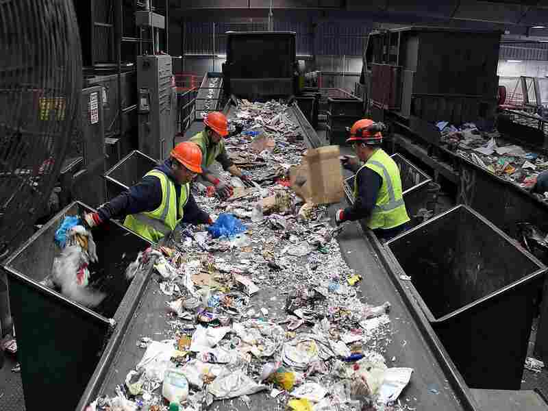 At Resource Management's material recovery facility, workers pull plastic bags, other trash and large pieces of cardboard off the conveyor belts before the mixed single-stream recyclables enter the sorting machines.