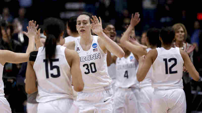 Raise your hand if you're not bored with winning: Connecticut's Breanna Stewart and teammates celebrate their 91-70 victory Monday over Dayton during a regional final game in the NCAA women's college basketball tournament in Albany, N.Y. The victory sent the team to its eighth straight Final Four, where it will pursue its third straight title.