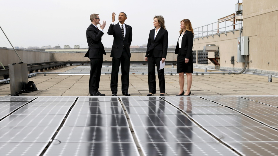 President Obama, seen here inspecting solar panels on the roof of the Department of Energy, has submitted a U.S. pledge to reduce greenhouse gases. (Kevin Lamarque/Reuters/Landov)