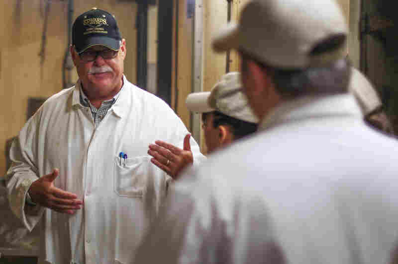 Sam Edwards is a fourth-generation country-ham curemaster in Surry, Va.