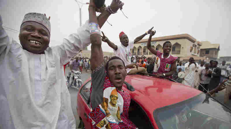 Supporters of Muhammadu Buhari celebrate ahead of their candidate's victory, in Kano, Nigeria, on Tuesday.