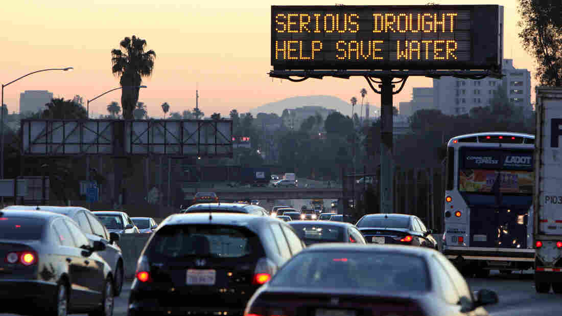 Morning traffic makes its way toward downtown Los Angeles along the Hollywood Freeway, past an electronic sign warning of severe drought. California Gov. Jerry Brown introduced the state's first mandatory water reduction measure this week.