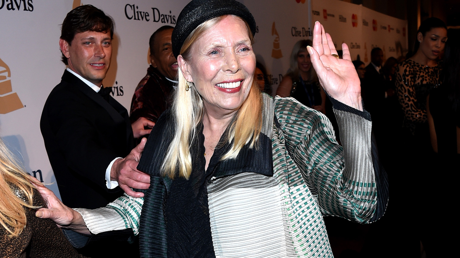 Musician Joni Mitchell attends a party before the Grammy Awards in February. Mitchell, 71, was found unconscious in her home Tuesday. (Getty Images)