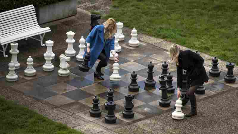 Prolonged nuclear talks gave Russian journalists time to play a game of giant chess in a courtyard of the Beau Rivage Palace Hotel in Lausanne, Switzerland, Wednesday.