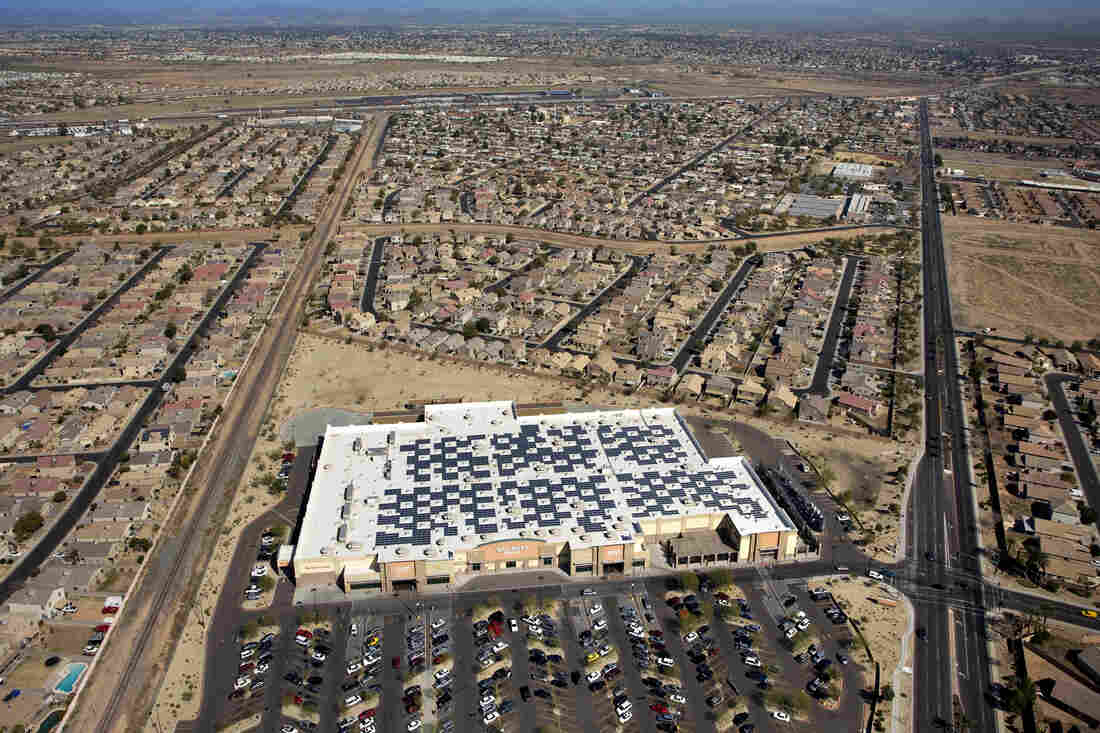 An aerial view of a Wal-Mart store in El Mirage, Ariz. Wal-Mart has long been a fixture in the suburban U.S., surrounded by residential properties and designed for a drive-in shopper.