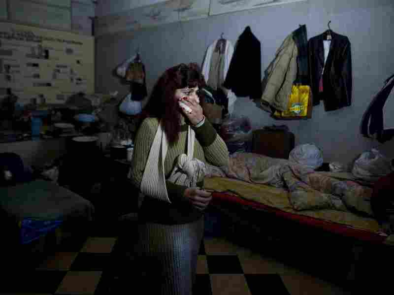 Tatjana stands March 6 in a Soviet-era bomb shelter near Donetsk's airport in eastern Ukraine. More than 200 people used the shelter at the height of the fighting between Ukrainian troops and pro-Russian separatist fighters. Many of those who fled the area ended up in nearby Kharkiv.