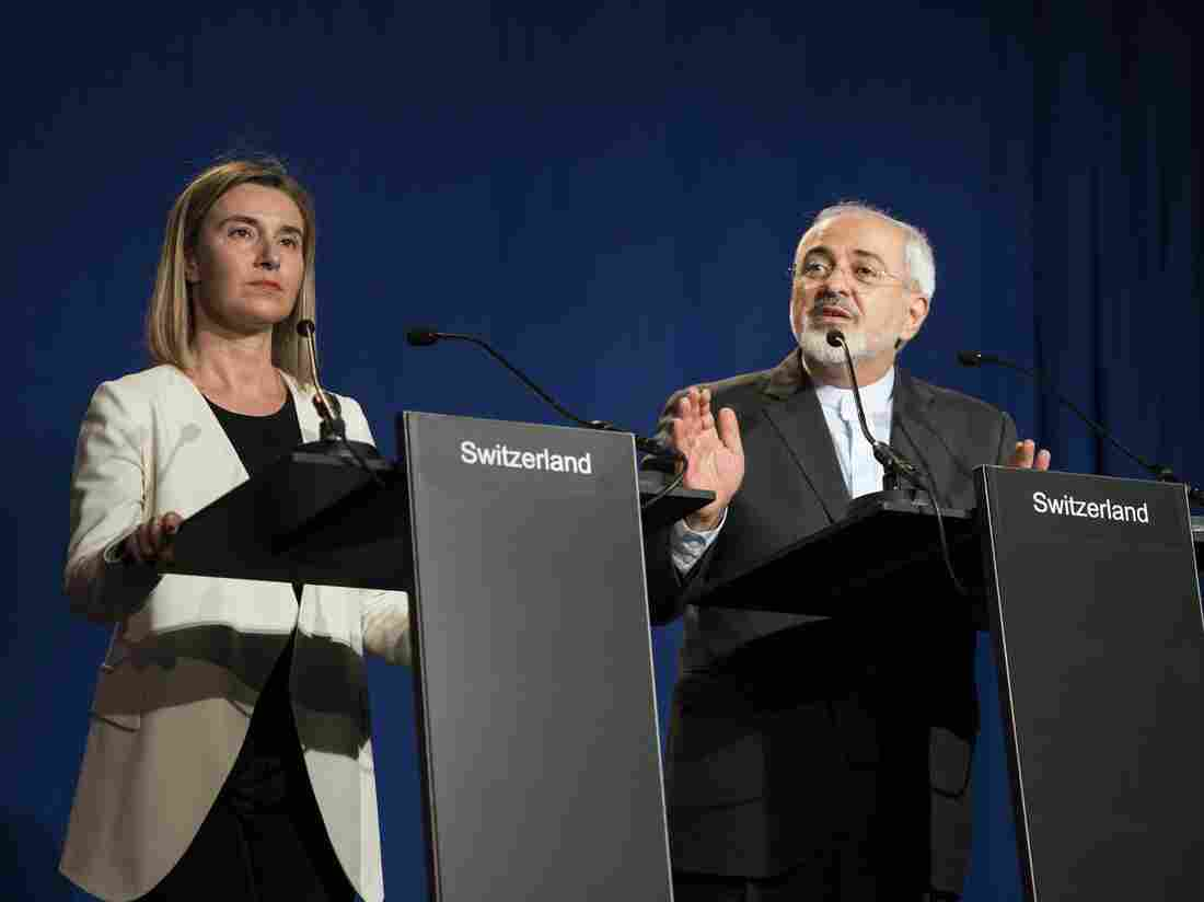 Iranian Foreign Minister Javad Zarif (right) delivers a statement, flanked by European Union High Representative for Foreign Affairs and Security Policy Federica Mogherini.