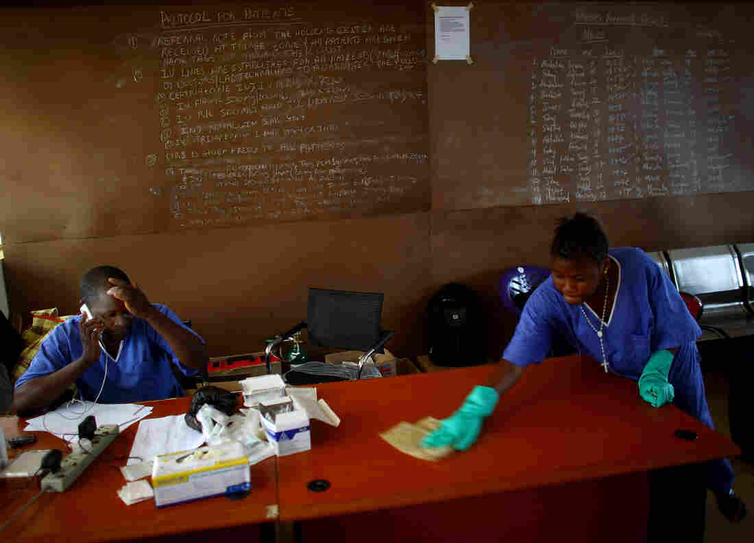 "The health workers of Sierra Leone — like Dr. Komba Songu M'Briwah (on the phone) — were dedicated to fighting Ebola. But they had a huge handicap. A government report reveals that some of the money allocated went to pay ""ghost workers."""