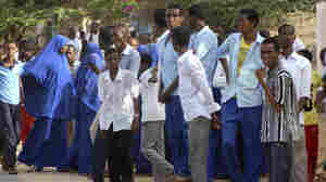 Students gather at a distance from the Garissa University College after an attack by gunmen in Garissa, Kenya, Thursday. The attack has injured dozens of people; a siege is ongoing.