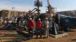 In this March 2014 photo, perforating tools, used to create fractures in rock, are lowered into one of six wells during a roughly two-week hydraulic fracturing operation near Mead, Colo.