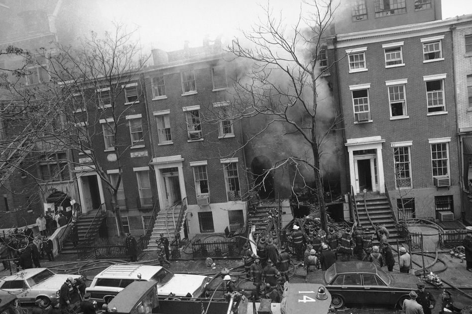 New York City firefighters work to put out a fire caused by explosions at 18 W. 11th St. on March 6, 1970. It was later discovered that the Weathermen, a radical left-wing organization, had been building bombs in the building's basement. (Marty Lederhandler/AP)