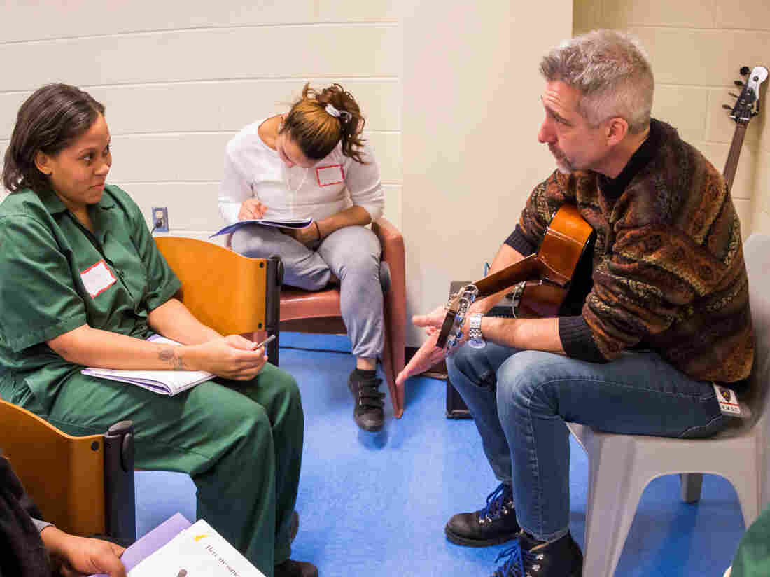 Daniel Levy works with Vateya (left) at the Rikers Island prison in New York City in February 2015, as part of the Lullaby Project.
