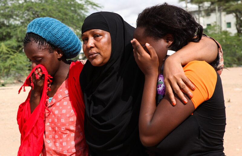Garissa University students comfort each other after they were rescued from Thursday's deadly attack.